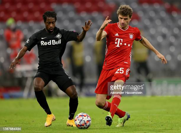 Thomas Mueller of Bayern Munich is challenged by Sekou Koita of RB Salzburg during the UEFA Champions League Group A stage match between FC Bayern...