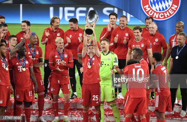 Thomas Mueller of Bayern Munich lifts the UEFA Super Cup trophy as he celebrates victory over FC Sevilla at Puskas Arena on September 24, 2020 in...