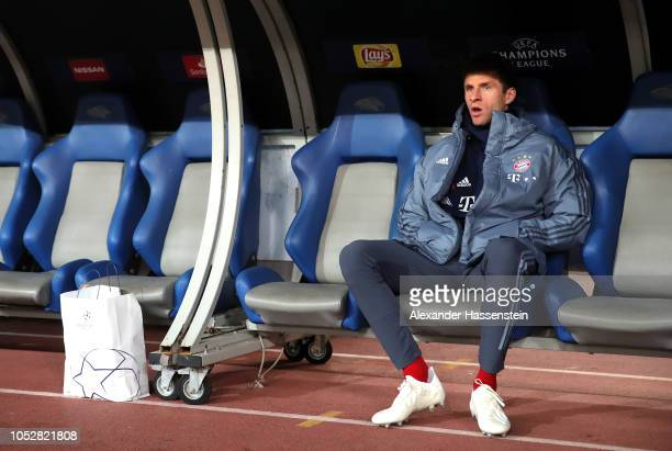Thomas Mueller of Bayern Munich looks on from the bench prior to the Group E match of the UEFA Champions League between AEK Athens and FC Bayern...