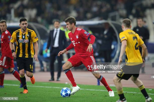 Thomas Mueller of Bayern Munich runs with the ball during the Group E match of the UEFA Champions League between AEK Athens and FC Bayern Muenchen at...