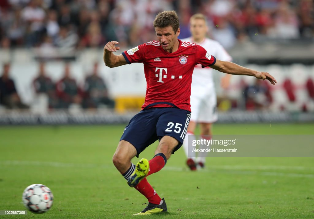 Thomas Mueller of Bayern Munich scores his team's third goal during the Bundesliga match between VfB Stuttgart and FC Bayern Muenchen at Mercedes-Benz Arena on September 1, 2018 in Stuttgart, Germany.