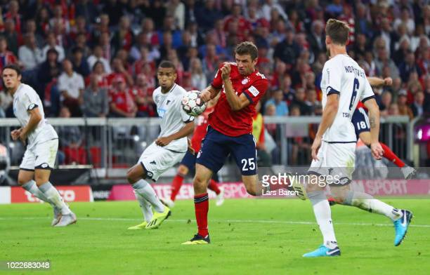 Thomas Mueller of Bayern Munich scores his team's third goal with a deflection but it is disallowed for a handball via VAR during the Bundesliga...