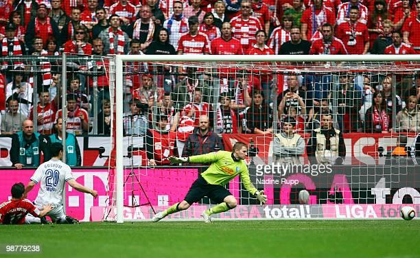 Thomas Mueller of Bayern scores his team's first goal against goalkeeper Philipp Heerwagen of Bochum during the Bundesliga match between FC Bayern...