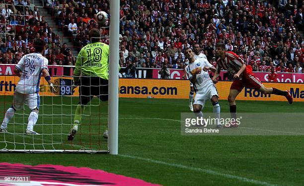 Thomas Mueller of Bayern scores the second goal against goalkeeper Philipp Heerwagen of Bochum during the Bundesliga match between FC Bayern Muenchen...