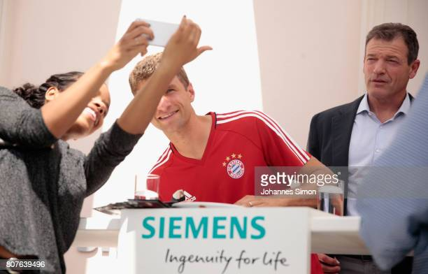 Thomas Mueller of Bayern signs autographs during the Siemens summer party after unveiling Siemens as new partner of FC Bayern Muenchen on July 4,...