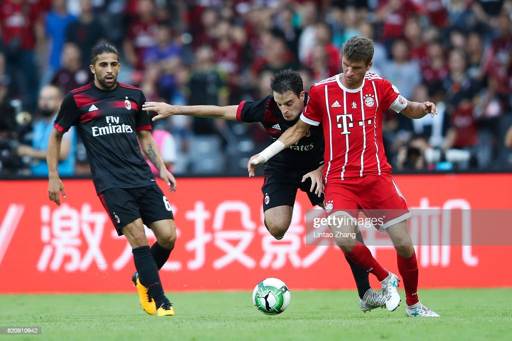 Thomas Mueller of FC Bayern competes for the ball with Giacomo Bonaventura of AC Milan during the 2017 International Champions Cup China match between FC Bayern and AC Milan at Universiade Sports Centre Stadium on July 22, 2017 in Shenzhen, China.
