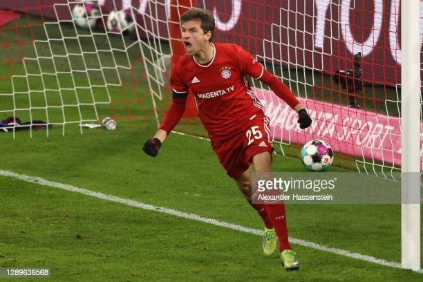 Thomas Mueller of FC Bayern München celebrates after scoring his team's third goal during the Bundesliga match between FC Bayern Muenchen and RB...