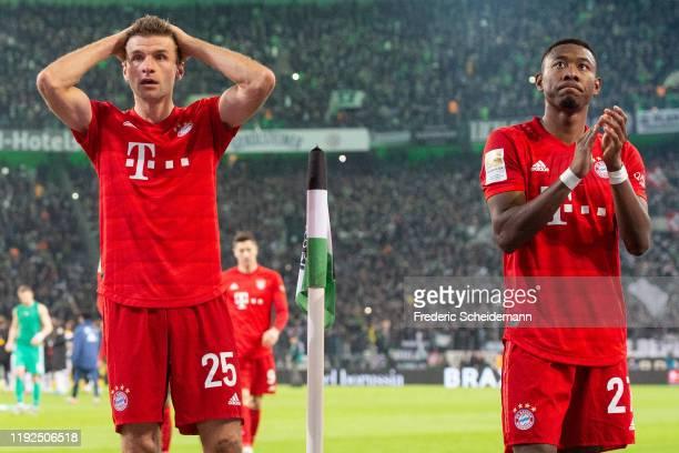 Thomas Mueller of FC Bayern Muenchen and David Alaba of FC Bayern Muenchen look dejected after the Bundesliga match between Borussia Moenchengladbach...