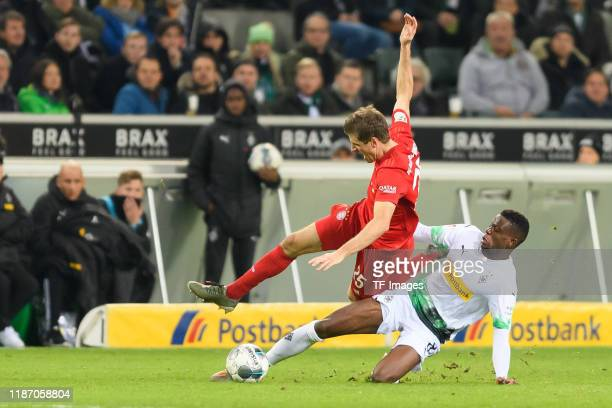 Thomas Mueller of FC Bayern Muenchen and Denis Zakaria of Borussia Moenchengladbach battle for the ball during the Bundesliga match between Borussia...