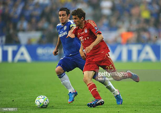 Thomas Mueller of FC Bayern Muenchen and Frank Lampard of Chelsea fight for the ball during UEFA Champions League Final between FC Bayern Muenchen...