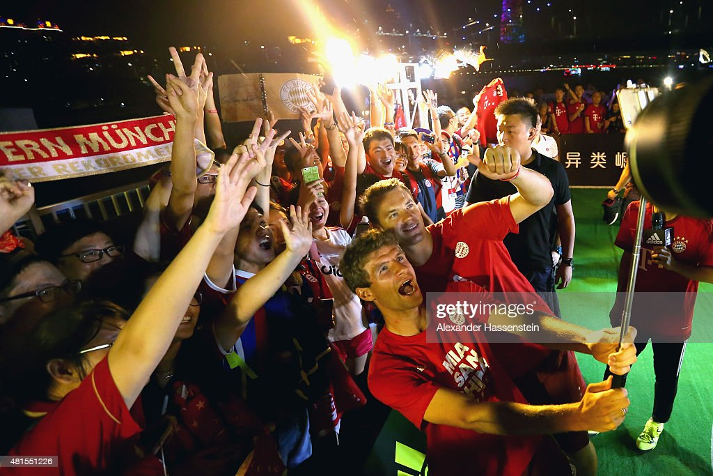 Thomas Mueller (L) of FC Bayern Muenchen and his team mate Manuel Neuer attends a fun football match at adidas marketing event on a cruise boat of the Guangzhou Pearl River at Dashatou Wharf on day 6 of the FC Bayern Audi China Summer Pre-Season Tour on July 22, 2015 in Guangzhou, China.