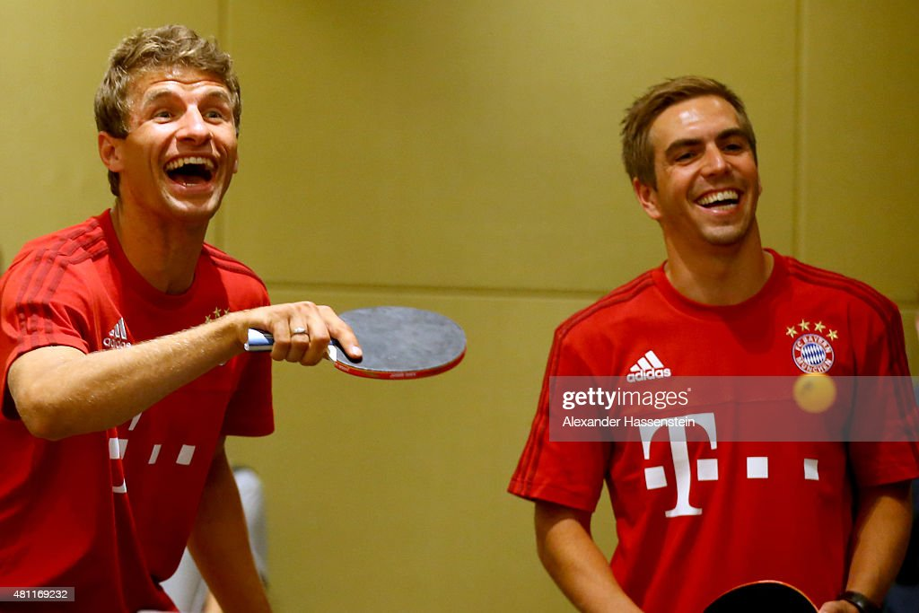 Thomas Mueller (L) of FC Bayern Muenchen and his team mate Philipp Lahm plays a table tennis match broadcasted live on TV at Inter Continental Beijing Beichen Hotel during day 2 of the FC Bayern Audi China Summer Pre-Season Tour on July 18, 2015 in Beijing, China.