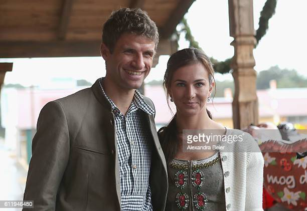 Thomas Mueller of FC Bayern Muenchen and his wife Lisa attend the Oktoberfest beer festival at Kaefer Wiesenschaenke tent at Theresienwiese on...