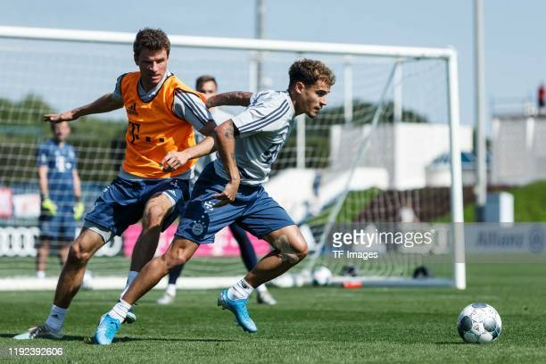 Thomas Mueller of FC Bayern Muenchen and Philippe Coutinho of FC Bayern Muenchen battle for the ball during day three of the FC Bayern Muenchen...
