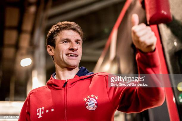 Thomas Mueller of FC Bayern Muenchen arrives with the bus prior to the Bundesliga match between RB Leipzig and FC Bayern Muenchen at Red Bull Arena...