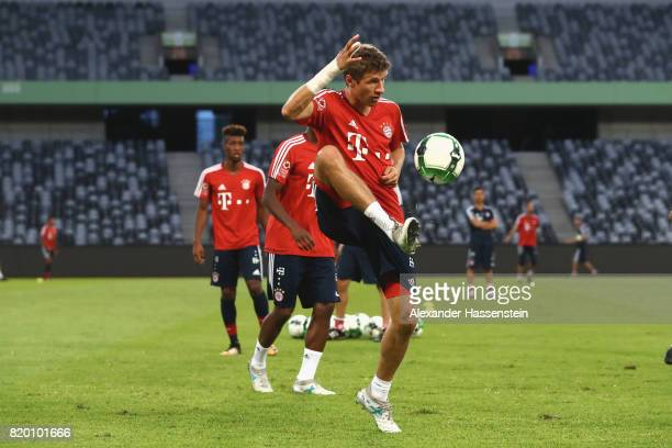 Thomas Mueller of FC Bayern Muenchen battles for the ball during a training session at Shenzhen Universiade Sports Centre during the Audi Summer Tour...