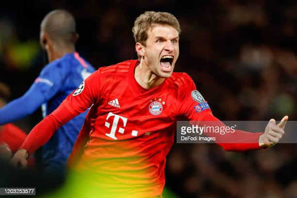 Thomas Mueller of FC Bayern Muenchen celebrates after scoring his team's first goal during the UEFA Champions League round of 16 first leg match...