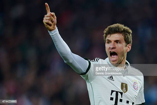 Thomas Mueller of FC Bayern Muenchen celebrates after scoring his team's first goal during the Bundesliga match between Hannover 96 and FC Bayern...