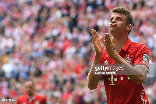 Thomas Mueller of FC Bayern Muenchen celebrates after scoring his team's second goal during the Bundesliga match between Bayern Muenchen and FC...
