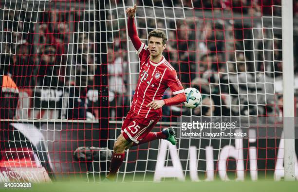 Thomas Mueller of FC Bayern Muenchen celebrates after scoring his team's second goal during the Bundesliga match between FC Bayern Muenchen and...