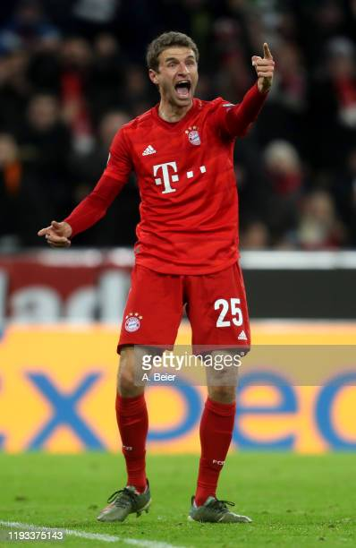Thomas Mueller of FC Bayern Muenchen celebrates his first goal during the UEFA Champions League group B match between Bayern Muenchen and Tottenham...