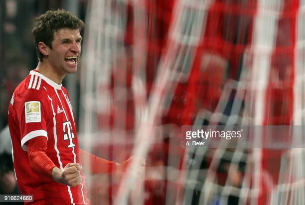 Thomas Mueller of FC Bayern Muenchen celebrates his first goal during the Bundesliga match between FC Bayern Muenchen and FC Schalke 04 at Allianz...