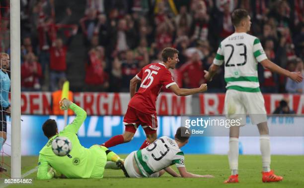 Thomas Mueller of FC Bayern Muenchen celebrates his first goal against goalkeeper Craig Gordon Kieran Tierney and Mikael Lustig of Celtic FC during...