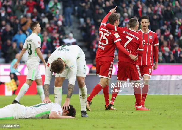 Thomas Mueller of FC Bayern Muenchen celebrates his first goal with teammates Franck Ribery and Robert Lewandowski during the Bundesliga match...