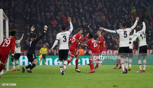 Thomas Mueller of FC Bayern Muenchen celebrates his first goal with teammates during the UEFA Champions League Round of 16 first leg match between FC...