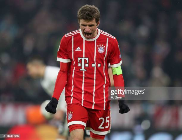 Thomas Mueller of FC Bayern Muenchen celebrates his second goal during the UEFA Champions League Round of 16 first leg match between FC Bayern...