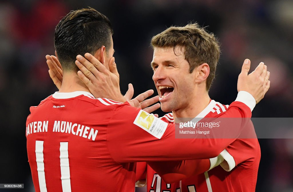 Thomas Mueller of FC Bayern Muenchen celebrates with his team-mates after scoring his team's fourth goal during the Bundesliga match between FC Bayern Muenchen and SV Werder Bremen at Allianz Arena on January 21, 2018 in Munich, Germany.