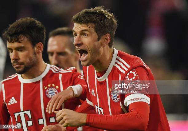 Thomas Mueller of FC Bayern Muenchen celebrates with his teammates after scoring his team's fourth goal during the Bundesliga match between FC Bayern...