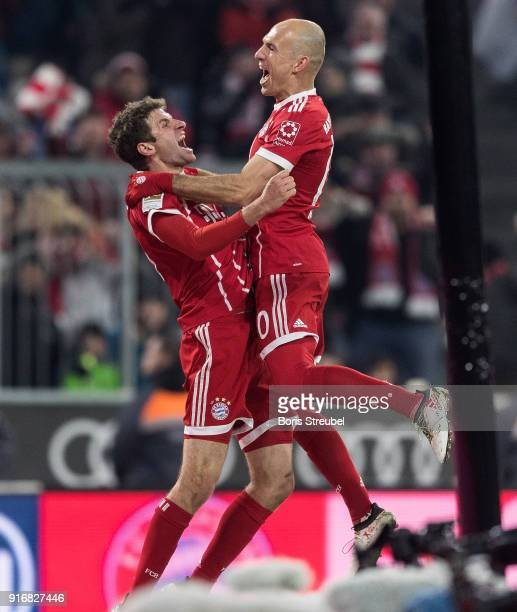 Thomas Mueller of FC Bayern Muenchen celebrates with team mate Arjen Robben of FC Bayern Muenchen after scoring his team's second goal during the...