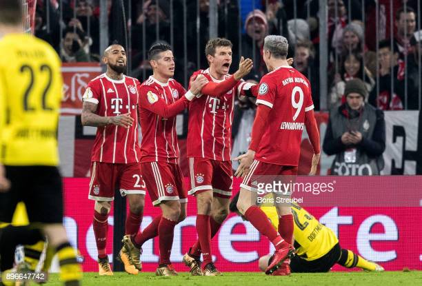 Thomas Mueller of FC Bayern Muenchen celebrates with team mates after scoring his team's second goal during the DFB Cup match between Bayern Muenchen...