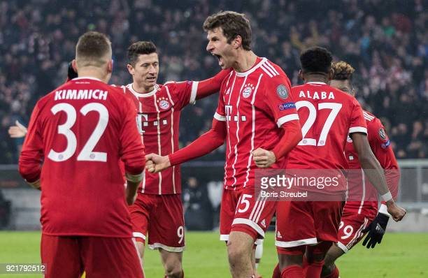 Thomas Mueller of FC Bayern Muenchen celebrates with team mates after scoring his team's first goal during the UEFA Champions League Round of 16...