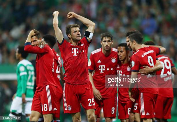 Thomas Mueller of FC Bayern Muenchen celebrates with teammates after scoring his team's second goal during the DFB Cup semi final match between...
