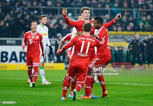 Thomas Mueller of FC Bayern Muenchen celebrates with teammates after scoring his team's second goal from the penalty spot during the Bundesliga match...