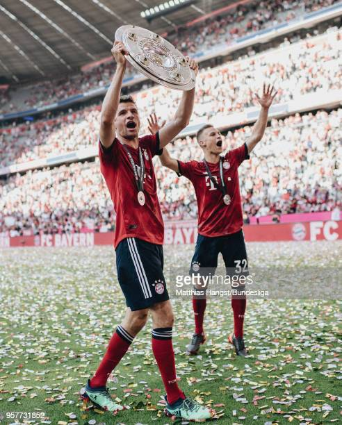 Thomas Mueller of FC Bayern Muenchen celebrates with the trophy Meisterschale after the Bundesliga match between FC Bayern Muenchen and VfB Stuttgart...