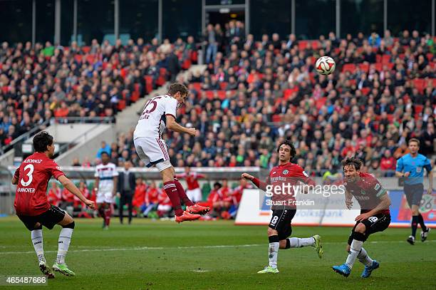 Thomas Mueller of FC Bayern Muenchen heads the third goal during the Bundesliga match between Hannover 96 and FC Bayern Muenchen at HDIArena on March...