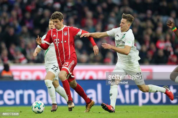 Thomas Mueller of FC Bayern Muenchen is challenged by Matthias Ostrzolek of Hannover 96 and Waldemar Anton of Hannover 96 during the Bundesliga match...