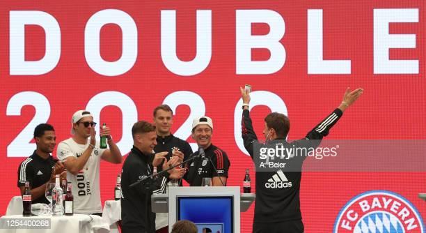 Thomas Mueller of FC Bayern Muenchen jokes next to teammates Serge Gnabry Leon Goretzka Joshua Kimmich goalkeeper Manuel Neuer and Robert Lewandowski...