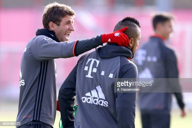Thomas Mueller of FC Bayern Muenchen jokes with his team mate Arturo Vidal during a training session at Saebener Strasse training ground on February...