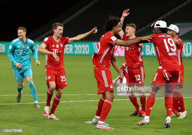 Thomas Mueller of FC Bayern Muenchen Joshua Kimmich of FC Bayern Muenchen and their teammates celebrate winning the DFB Cup final match between Bayer...