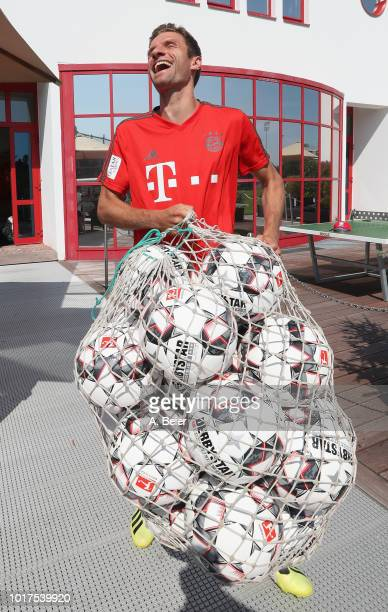 James Rodriguez and Robert Lewandowski of FC Bayern Muenchen warm up during a training session at the club's Saebener Strasse training ground on...