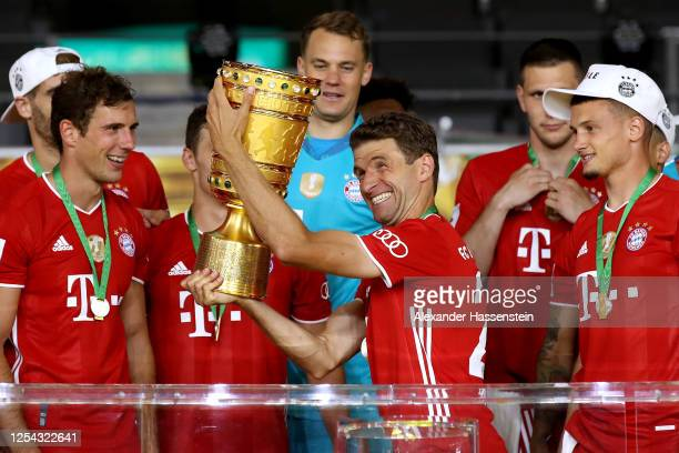 Thomas Mueller of FC Bayern Muenchen lifts the DFB Cup winners trophy in celebration after the DFB Cup final match between Bayer 04 Leverkusen and FC...