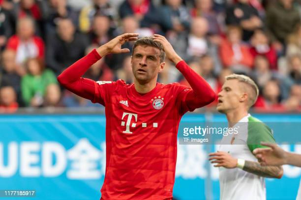 Thomas Mueller of FC Bayern Muenchen looks dejected during the Bundesliga match between FC Augsburg and FC Bayern Muenchen at WWK-Arena on October...