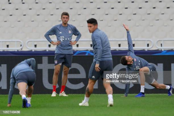 Thomas Mueller of FC Bayern Muenchen looks on during a training session ahead of their UEFA Champions League Group E match against AEK Athens at...