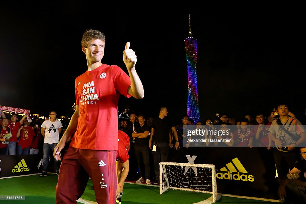 Thomas Mueller of FC Bayern Muenchen plays a fun football match at adidas marketing event on a cruise boat of the Guangzhou Pearl River at Dashatou Wharf on day 6 of the FC Bayern Audi China Summer Pre-Season Tour on July 22, 2015 in Guangzhou, China.