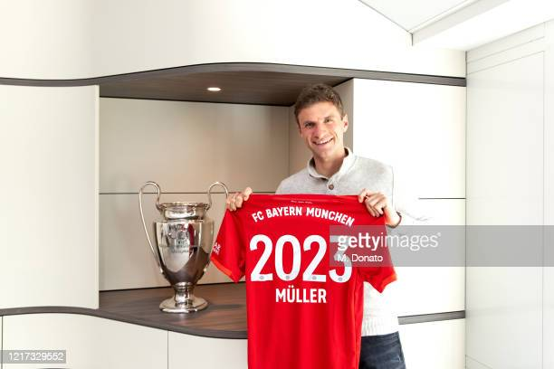 Thomas Mueller of FC Bayern Muenchen poses with a jersey after his contract was extended until 2023 on April 07, 2020 in Munich, Germany.
