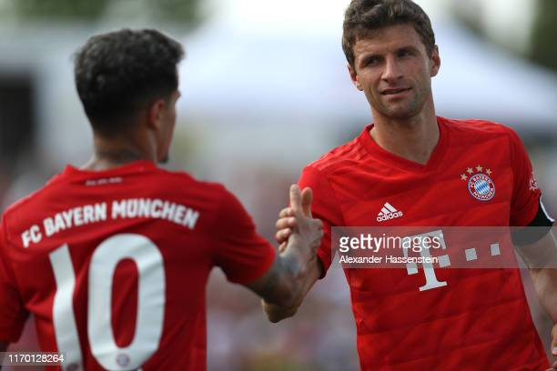 Thomas Mueller of FC Bayern Muenchen reacts with his team mate Philippe Coutinho during the Traumspiel between Vilshofen Rot Weiss and FC Bayern...